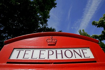 "Haworth, GBR, 15.August.2005 - Sign with the word ""Telephone"" on top of an old phone box in Haworth"