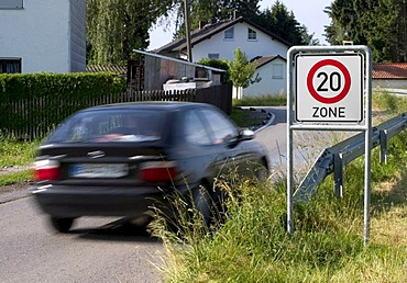 Markt Schwaben, GER, 26. June 2006 - A car passes a sign which marks the begin of a speed limited zone in Markt Schwaben Bavaria Germany.