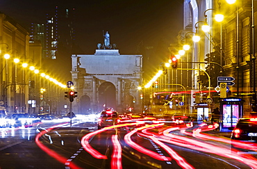 View over Ludwigstrasse towards Siegestor at night Munich Bavaria Germany