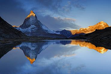 Matterhorn at sunrise at the Riffelsee, Zermatt, Valais, Switzerland