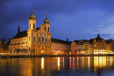 Lights of the St. Francis Xavier Jesuit Church reflected on the surface of the Reuss River, Lucerne, Switzerland