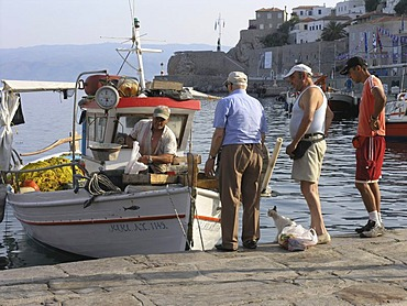 Port harbour fisherman selling his catch fresh off the boat Hydra Saronic island Greece