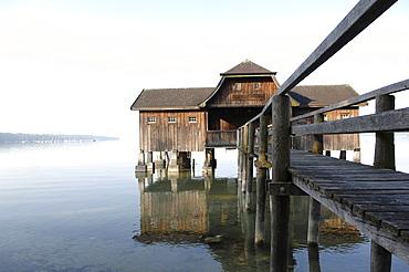 Building on stilts, wooden house, Stegen, Lake Ammersee, Upper Bavaria, Germany, Europe
