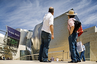Visitors standing in front of Guggenheim Museum, Bilbao, Basque Country, Spain, Europe