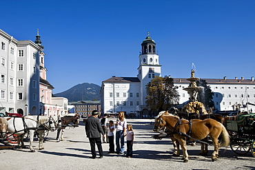 Residenzplatz Square and Residenzbrunnen Fountain, Michaeliskirche Church and the new building of the residency with chime of bells, Salzburg, Europa