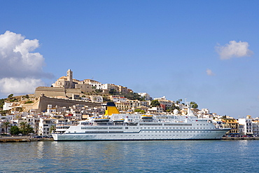 View over a ferry in the harbour of the historic city Dalt Vila, Ibiza, Balearic Islands, Spain, Europe