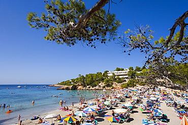 Tourists on the beach of Portinatx, Ibiza, Balearic Islands, Spain, Europe
