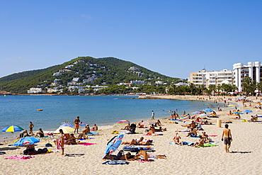 Tourists on the beach of Santa Eularia des Riu, Ibiza, Balearic Islands, Spain, Europe