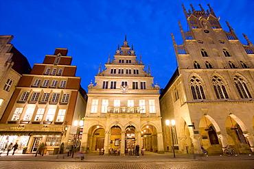 Lit-up city hall and Stadtweinhaus or City Wine House at Prinzipalmarkt, Muenster, North Rhine-Westphalia, Germany, Europe