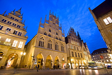 Lit-up city hall and Stadtweinhaus or City Wine House at Prinzipalmarkt, Muenster, North Rhine-Westphalia, Germany, Europe