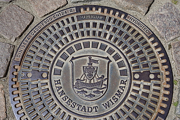 Coat of arms of Wismar on a manhole cover, Wismar, Mecklenburg-Western Pomerania, Germany, Europe