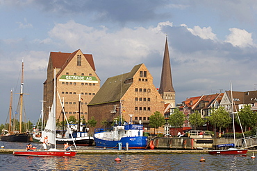 St. Peter's Church and warehouses on the Warnow River, Rostock, Mecklenburg-Western Pomerania, Germany, Europe