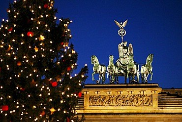 Brandenburger Tor Brandenburg gate with Quadriga with christmas tree Berlin Germany