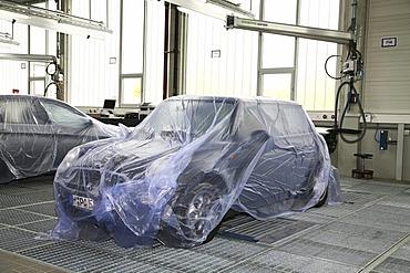 Garage: BMW Mini covered by tarpaulin