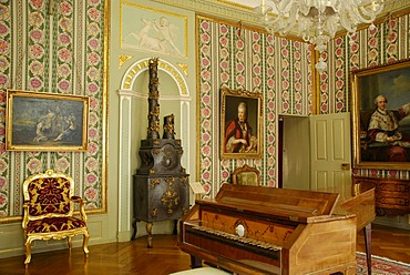 Rococo room containing a harpsichord and a wood-burning stove, in the Kurpfaelzischen Museum, Heidelberg, Baden-Wuerttemberg, Germany, Europe