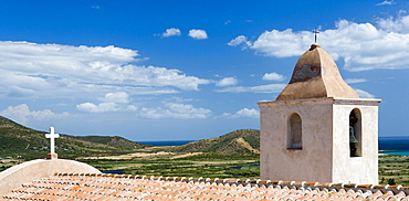 View over the roof of an old church and the countryside of Posada, Sardinia, Italy