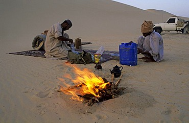 Desert camp with camp fire in the sand dunes, Libya