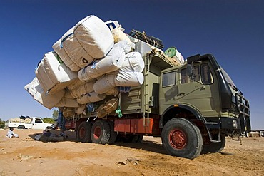 Totally overloaded truck at the oasis of Kufra, Kufrah, Al Kufrah