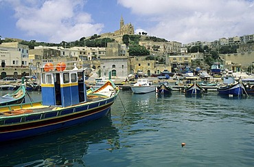 Luzzu boats in the harbour of Mgarr, Gozo island, Malta