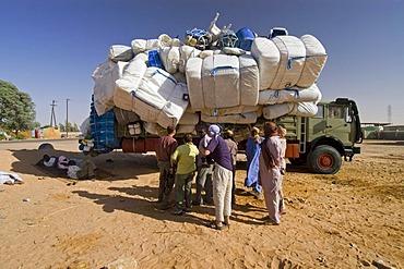 Totally overloaded truck at the oasis of Kufra, Kufrah, Al Kufrah, Libya