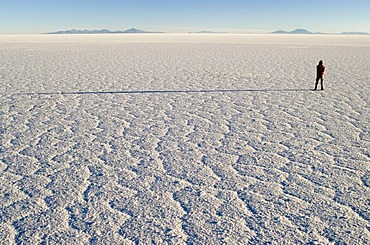 Person standing on Salar de Uyuni, Bolivia