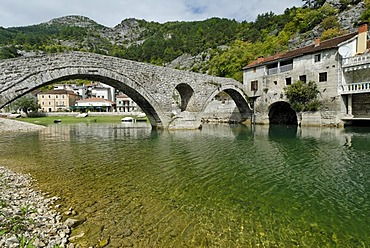 Historic stone bridge in Rijeka Crnojevica at Skutari lake, Montenegro