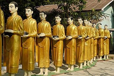 Statues of monks in a monastery, Yangon, Myanmar