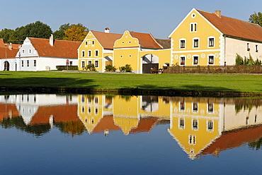 Village square with fire pond of Zabori, south Bohemia, Czech Republic