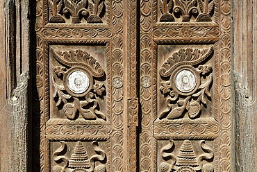 Carved wooden door in the old town of Bhaktapur, Kathmandu valley, Nepal