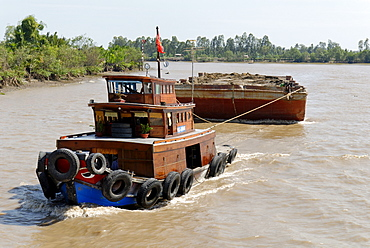 Ships and boats on the Mekong river, Vietnam
