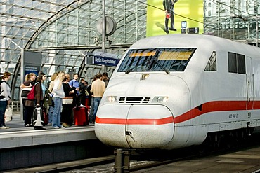 Travellers on the platform at the central station, Berlin, Germany