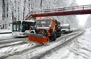 Snow plow clearing Highway B327 after a winter blizzard between Koblenz and Waldesch, Rhineland-Palatinate, Germany