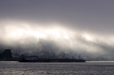 Container ship in fog, Rhine River, Lorch, Rhineland-Palatinate, Germany, Europe