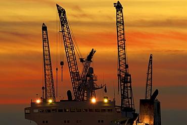 View from the Landungsbruecken Hamburg at sunset, industrial cranes, Hamburg, Germany