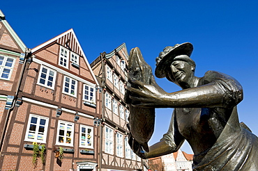 Fisherwoman Statue in the historic centre of Stade, Lower Saxony, Germany, Europe