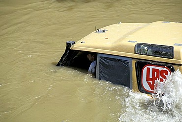 Offroad vehicle is sinking into deep water