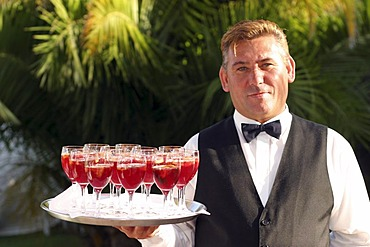 Waiter with cocktails