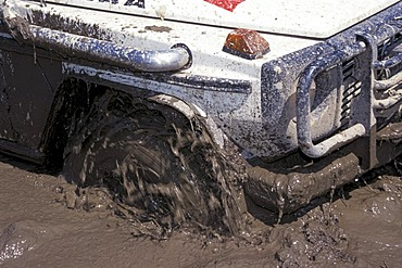 Spinning tyre in mud