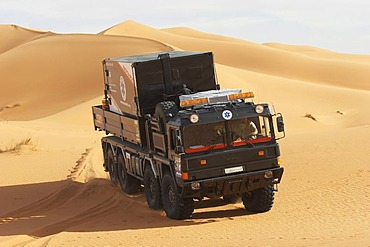 MAN truck with a emergency box on top in the dunes, Lybia