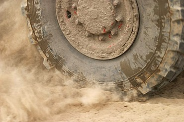 Wheel in dust
