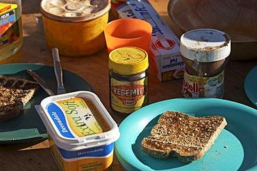Vegemite, nutella, toast, butter on the breakfast table