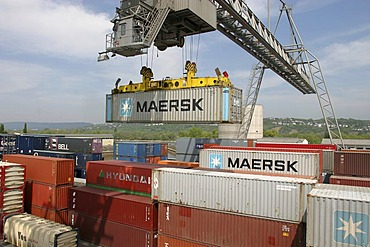 A gantry crane loading nestable containers . Koblenz, Rhineland-Palatinate, Germany