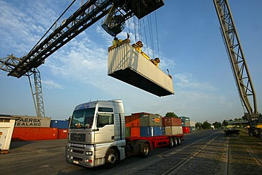 A crane loading container on a truck. Koblenz, Rhineland-Palatinate, Germany