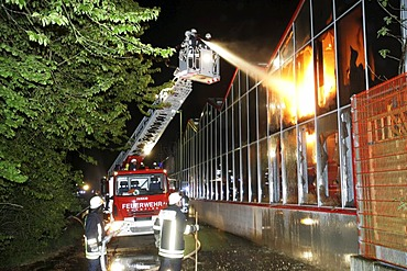 Firefighter put out the fire in an gardenmarket in Treis-Karden, Rhineland-Palatinate Germany