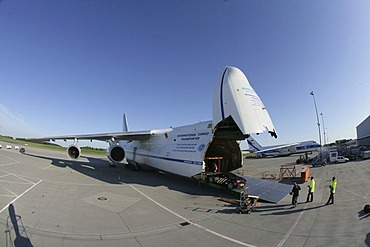 """Sportscars competing in the illegal car-race """"Gumball 3000"""" are loaded into two Antonov cargo-aircrafts. Frankfurt/Hahn, Rhineland-Palatinate, Germany"""