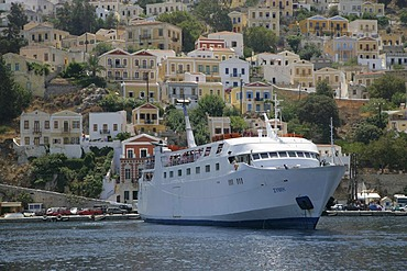 Ferry boat in the Port of the Isle of Symi near Rhodes, Greece, Europe
