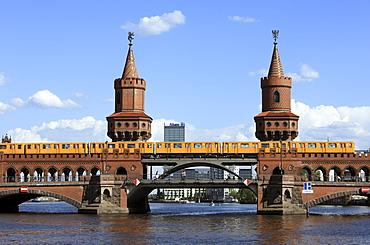 Tube U1 on the Oberbaumbruecke Bridge crossing Berlin Spree River in Friedrichshain-Kreuzberg, Berlin, Germany, Europe