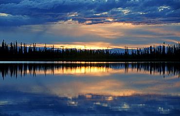 Sunset reflected on a lake in southeastern Alaska, USA