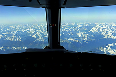 View from the cockpit of an Airbus 321, in flight over the Alps