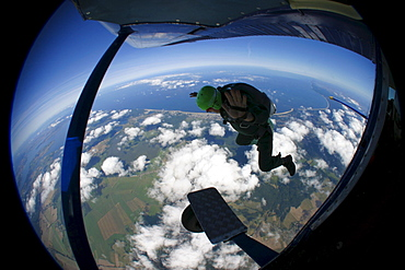 Parachutist leaving the aircraft